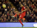 Liverpool's Raheem Sterling scores the opening goal in their match against Sunderland on January 2, 2013