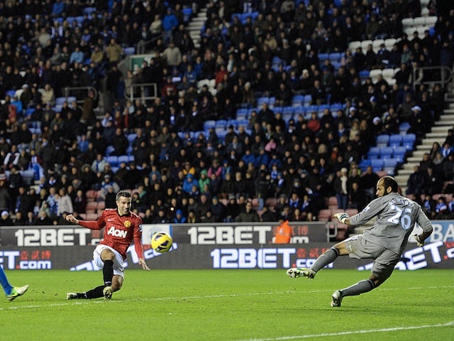 Robin Van Persie scores United's fourth against Wigan on January 1, 2013