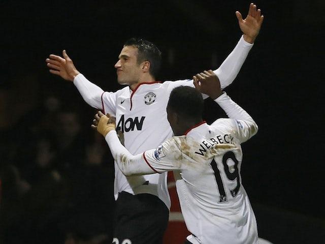 United striker Robin Van Persie celebrates  late equaliser against West Ham on January 5, 2013