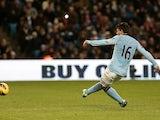 Man City striker Sergio Aguero scores a penalty against Stoke on January 1, 2013