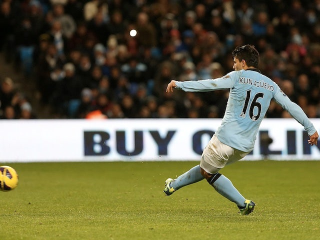 Man City striker Sergio Aguero scores a penalty against Stoke on January 1, 2013