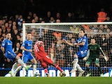 QPR's Shaun Wright-Phillips drives a shot into the bottom corner to open the scoring against Chelsea on January 2, 2013