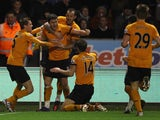 Stephen Ward of Wolverhampton Wanderers celebrates with team mates as he scxores their first goal during the Barclays Premier League match against Chelsea on January 2, 2012