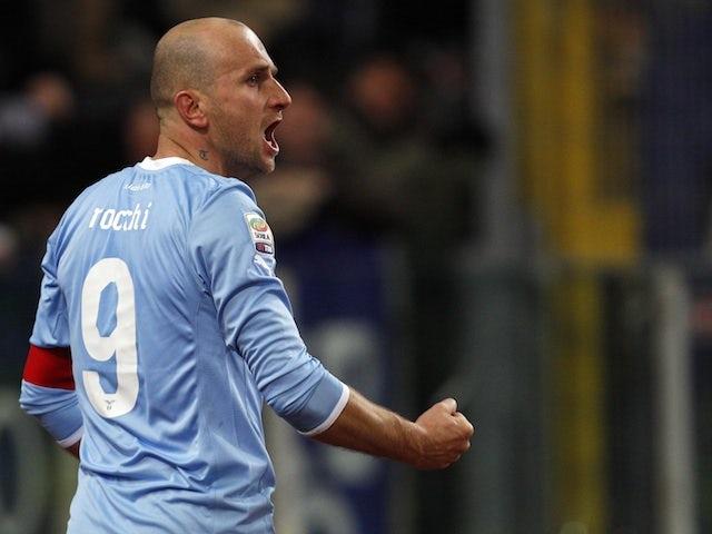 Lazio's Tommaso Rocchi celebrates a goal against Milan on February 1, 2012