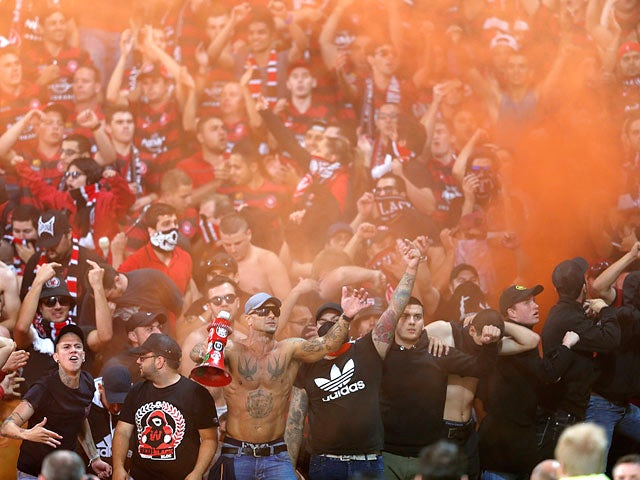 Western Sydney Wanderers fans let off flares during the A-League match against Melbourne Victory on December 28, 2013