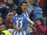 Real Sociedad's Xabi Prieto is congratulated by Carlos Vela following his penalty against Real Madrid on January 6, 2013