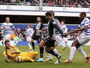 Spurs' Aaron Lennon is thwarted by QPR keeper Julio Cesar on January 12, 2013
