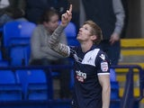 Andy Keogh celebrates after opening the scoring through a penalty against Bolton on January 12, 2013