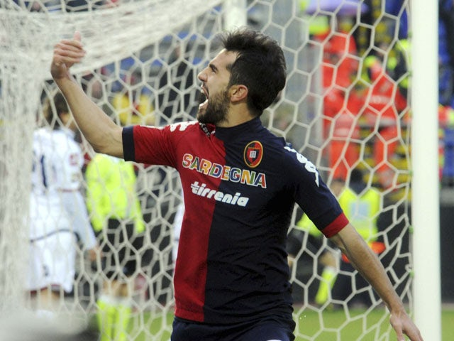 Cagliari forward Marco Sau celebrates scoring his sides first goal against Genoa in their Serie A clash on January 13, 2013