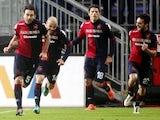 Daniele Conti celebrates scoring Cagliari's second goal in their Serie A match against Genoa on January 13, 2013