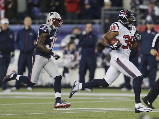 Texans' Danieal Manning returns the game's first kick-off for 94 yards against New England on January 13, 2013