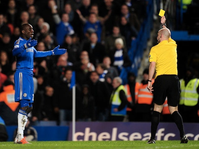 Chelsea forward Demba Ba is booked for diving against Swansea on January 9, 2013
