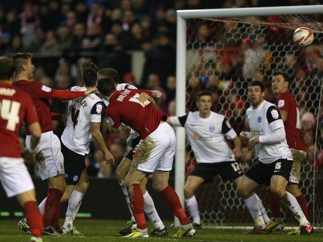 Forest's Elliott Ward heads in the winner against Peterborough on January 12, 2013