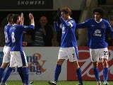 Nikica Jelavic celebrates with team mates after scoring the opener against Cheltenham in the FA Cup on January 7, 2013