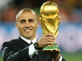 Fabio Cannavaro of Italy presents the World Cup trophy prior to Netherlands v Spain final 11 July, 2010