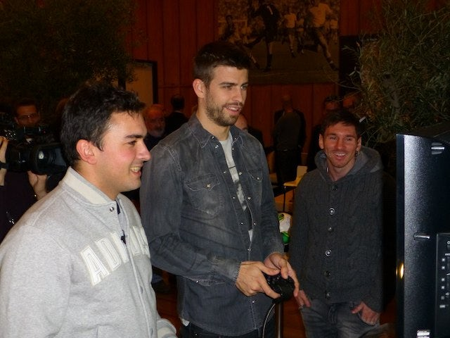 Gerard Pique and Lionel Messi playing FIFA