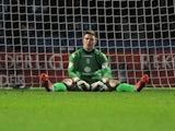 Birmingham goalie Jack Butland sits dejected after a late Huddersfield equaliser on January 12, 2013