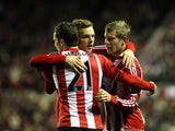 James McClean celebrates with team mates after scoring his team's third goal on January 12, 2013