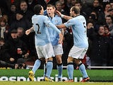 City midfielder James Milner celebrates with teammates after his goal against Arsenal on January 13, 2013