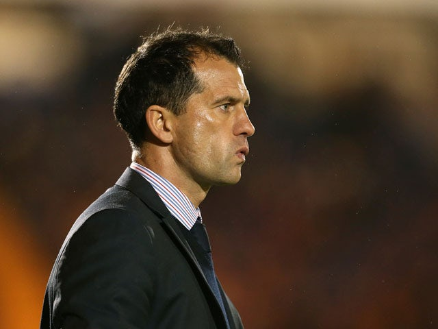 Colchester United manager Joe Dunne looks on as his side plays Coventry City on 20 November, 2012