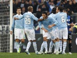 Lazio forward Sergio Floccari celebrates with teammates after scoring in his sides Serie A match with Atalanta on January 13, 2013