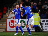 Leighton Baines celebrates with Marouane Fellaini after scoring his team's second goal against Cheltenham in the FA Cup on January 7, 2013