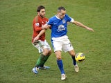 Everton midfielder Leon Osman battles with Swansea's Angel Rangel during the game on January 12, 2013