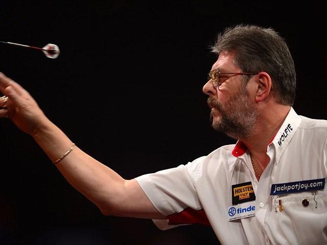 Martin Adams throws a dart on January 6, 2013