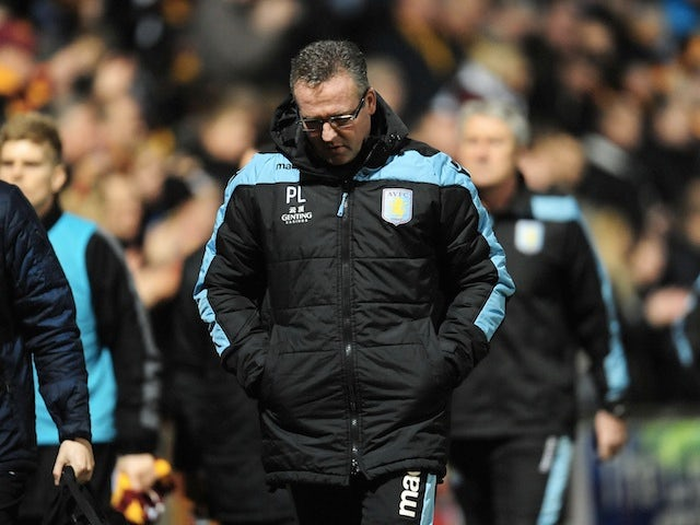 Villa boss Paul Lambert cuts a dejected figure on the touchline in the defeat to Bradford on January 8, 2013