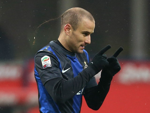 Inter's Rodrigo Palacio celebrates scoring the opening goal against Pescara on January 12, 2013