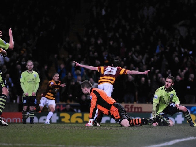 Bradford's Rory McArdle wheels away in delight after scoring the second against Villa on January 8, 2013