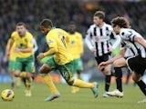 Norwich striker Simeon Jackson turns away from Newcastle's Fabricio Coloccini on January 12, 2013