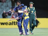 Lahiru Thirimanne (left) celebrates scoring a century for Sri Lanka against Australia on 13 January, 2013