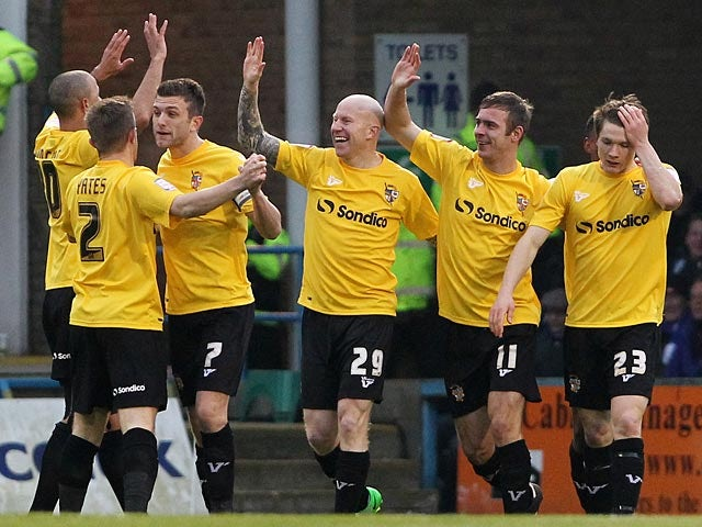Port Vales's Tom Pope is congratulated by team mates after scoring the opener against Gillingham on January 12, 2013