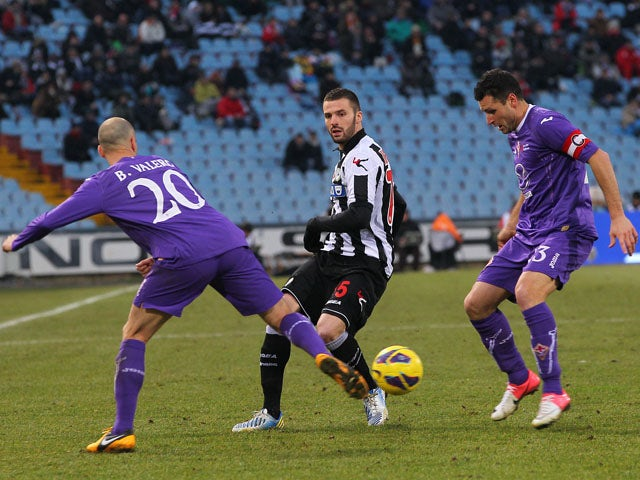 Fiorentina player Borja Valero challenges for the ball in his sides game with Udinese on January 13, 2013