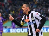 Udinese forward Antonio Di Natale celebrates after scoring against Fiorentina in their Serie A clash on January 13, 2013