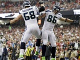 Seahawks TE Zach Miller celebrates a touchdown with Breno Giacomini after a touchdown after Atlanta on January 13, 2013