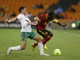 Morocco's Abderrahim Achchakir challenges Geraldo Bartolomeu of Angola during their African Nations Cup match on January 19, 2013