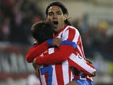 Athletico's Adrian Lopez is congratulated by Radamel Falcao after a goal against Levante on January 20, 2013