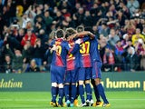 Barcelona players celebrate their second goal against Malaga in the Copa del Rey on January 16, 2013