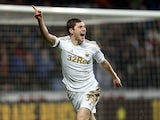 Swansea defender Ben Davies celebrates his goal against Stoke on January 19, 2013