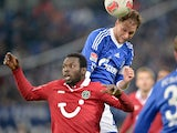 Schalke's Benedikt Hoewedes and Hannover's Mame Biram Diouf battle for the ball in the air on January 18, 2013