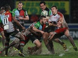 Harlequins' Danny Care is tackled during the match against Biarritz on January 18, 2013