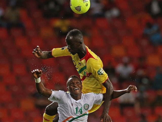 Mali's Diawara Fousseyni battles with Garba Boubacar of Niger during an African Nations Cup match on January 20, 2013