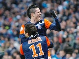 Montpellier's Emanuel Herrera is congratulated by Remy Cabella after a goal against Marseille on January 19, 2013