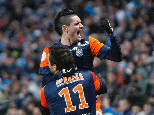 Emanuel Herrera is congratulated by team mate Remy Cabella after scoring the equaliser against Marseille on January 19, 2013