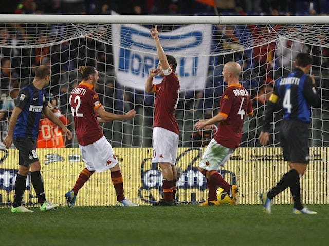 Roma forward Francesco Totti celebrates a goal against Inter Milan on January 20, 2013