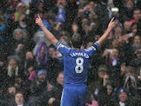 Frank Lampard celebrates in front of the Chelsea fans after scoring a penalty and his team's second goal against Arsenal on January 20, 2013