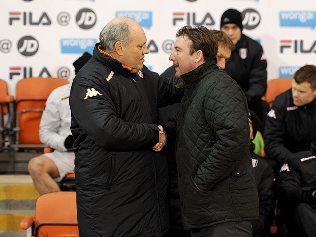 Fulham manager Martin Jol and Blackpool caretaker manager Steve Thompson before their sides FA Cup match on January 15, 2013