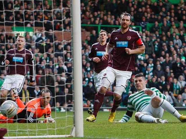 Celtic's Gary Hooper slots in the opener against Hearts on January 19, 2013